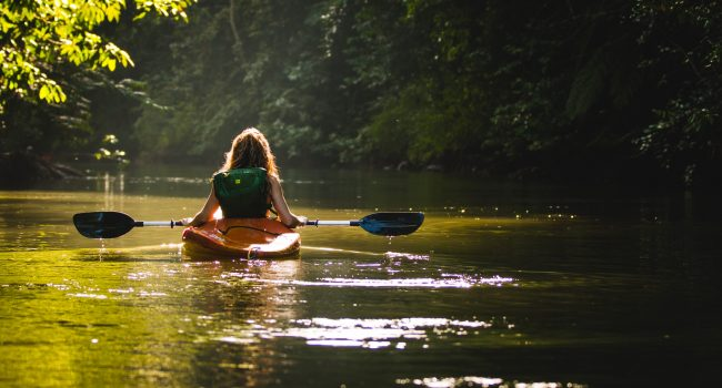woman kayaking on Orara River Coffs hinterland